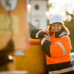 Portrait of senior woman engineer wearing protective workwear - outdoor